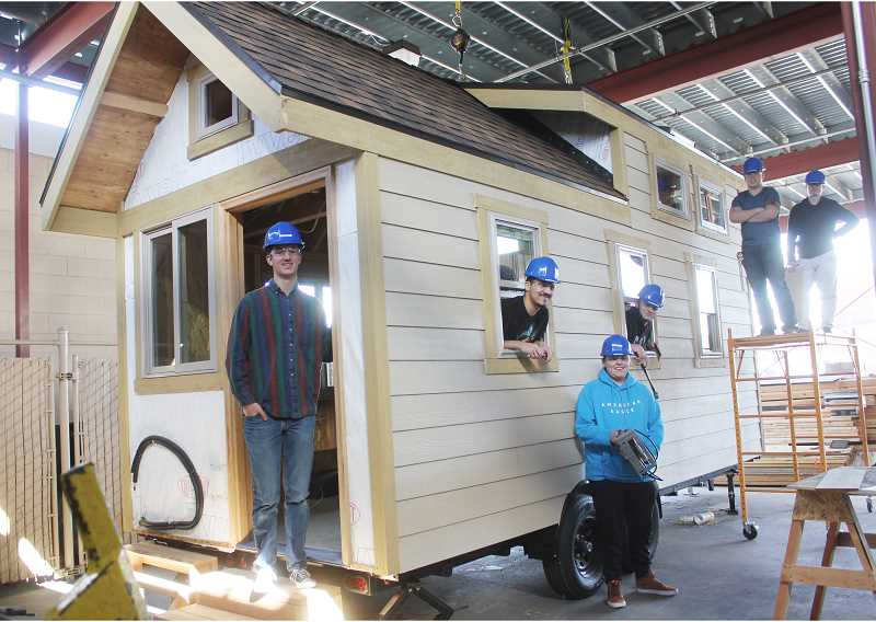 students building tiny house